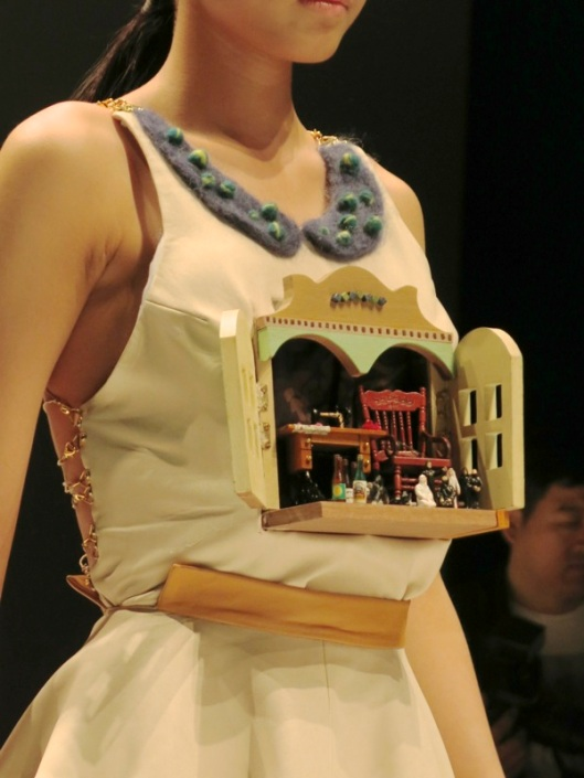 "Got to love the ""secret"" Swiss Cuckoo-clock feel of this dress from the school of Hongzhuo"