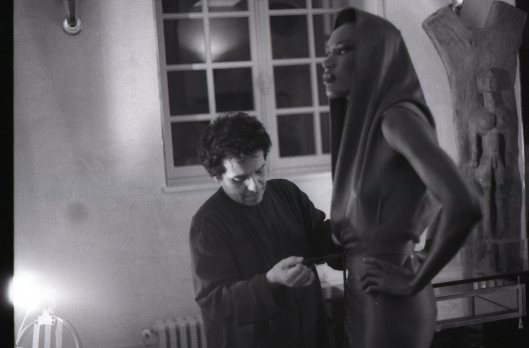 Azzedine adjusting Grace Jones in his studio before a private shoot.