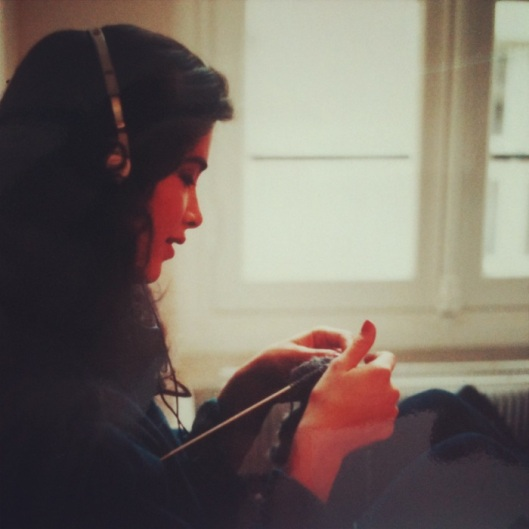 Linda, listening to her walkman, knitting between shows.