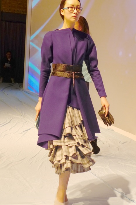 I loved how the student balanced the heavy ruffled skirt with the prim coat.