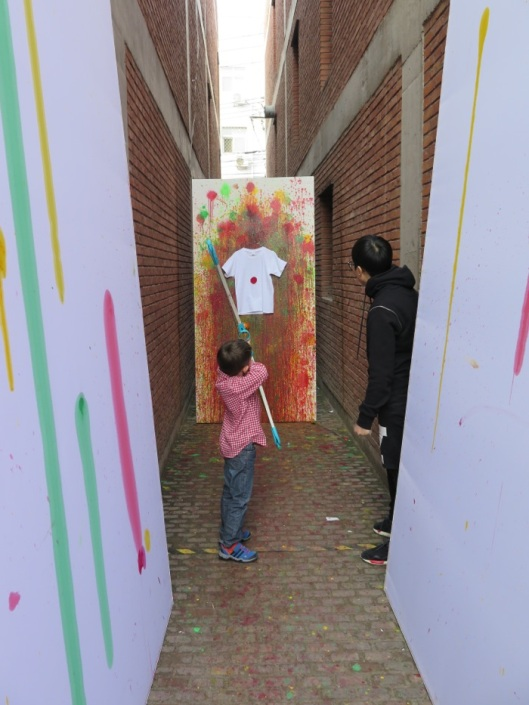My kid designing his colored T-Shirt at the CAFA stand.