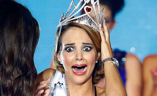 "Laetitia Guarino 'Miss Switzerland 2014"" in her best ""What? ME???"" moment..."